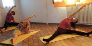etirement du grand dorsal en stage de yoga